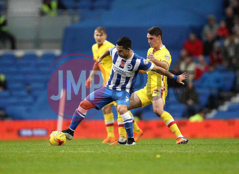 Biram Kayal of Brighton & Hove Albion holds off Darren Potter of Milton Keynes Dons - Mandatory byline: Robbie Stephenson/JMP - 07966 386802 - 07/11/2015 - FOOTBALL - Falmer Stadium - Brighton, England - Brighton v MK Dons - Sky Bet Championship