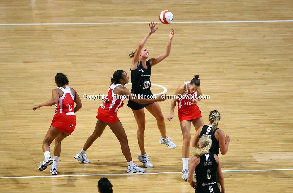 PICTURE BY VAUGHN RIDLEY/SWPIX.COM...Netball - International Netball Series - England v New Zealand - MEN Arena, Manchester, England - 15/01/11...New Zealand's Casey Williams grabs a high ball.