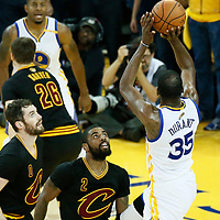 12 June 2017: Golden State Warriors forward Kevin Durant (35) takes a jump shot over Cleveland Cavaliers guard Kyrie Irving (2) and Cleveland Cavaliers forward Kevin Love (0) during the Golden State Warriors 129-120 victory over the Cleveland Cavaliers, in game 5 of the 2017 NBA Finals, at the Oracle Arena, Oakland, California, USA.