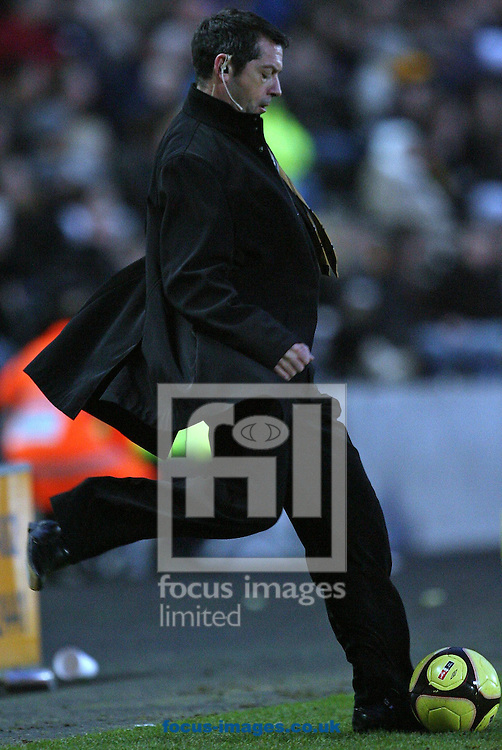 Hull - Saturday, January 24th, 2009:  Hull City manager Phill Brown returns the ball during the FA Cup fourth round match at the KC Stadium, Hull. (Pic by Darren Walker/Focus Images)