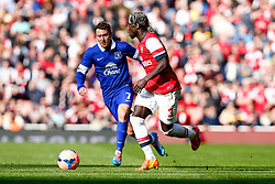 Arsenal Defender Bacary Sagna (FRA) is challenged by Everton Midfielder Aidan McGeady (IRL) - Photo mandatory by-line: Rogan Thomson/JMP - 07966 386802 - 08/03/14 - SPORT - FOOTBALL - Emirates Stadium, London - Arsenal v Everton - FA Cup Quarter Final.