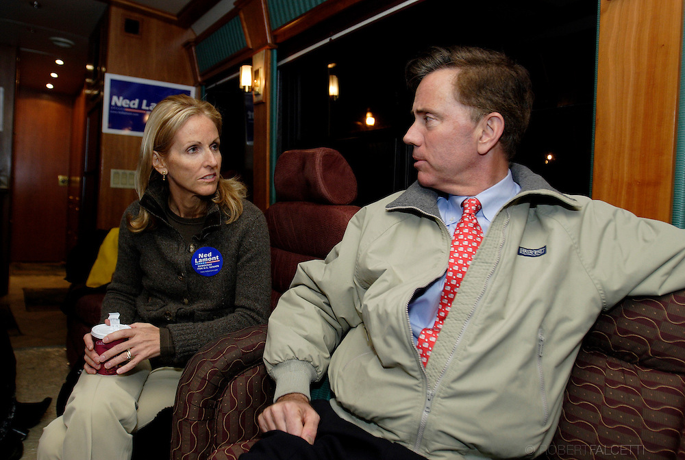 "NAUGATUCK, CT - NOVEMBER 3:  Democratic candidate for U.S. Senate Ned Lamont and his wife Annie share a moment on the bus that the Lamont campaign has used for what they call ""Stand up for Change Bus Tour"". The bus tour concludes Saturday after 3 days and campaign stops in 18 Connecticut cities. The Lamonts were campaigning at the Naugatuck High School football field prior to a game November 3, 2006 in Naugatuck, Connecticut. Lamont is in a tight race with Sen. Joe Lieberman (D-CT) for the Senate seat.  (Photo by Bob Falcetti/Getty Images)"