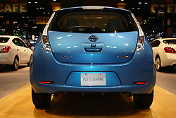 """08 February 2012:  2012 NISSAN LEAF: As a 100-percent electric powered, medium-size hatchback, the Nissan Leaf is based on a lithium-ion battery-powered chassis, and offered for 2012 in Leaf SV and Leaf SL trim packages. The battery powers a high-response 80kW AC synchronous motor, rated at 107 horsepower and 207 lb-ft of torque, which drives the front wheels through a single speed reducer. When equipped with a quick charge port and using a DC fast charger, the Leaf can be charged up to 80 percent of its full capacity in 30 minutes. Charging at home through a 220V outlet takes approximately eight hours, and the Leaf has a range of 100 miles on one full charge to satisfy real-world consumer requirements. The advanced lithium-ion battery pack carries an industry-competitive warranty of 8 years or 100,000 miles. Now in its second year of production, the Leaf's latest features include a photovoltaic solar panel spoiler that supports charging of the accessories 12-volt battery, and an """"Approaching Vehicle Sound for Pedestrians"""" system. The Leaf offers comfortable seating for five adults, and with the 60/40 split folding rear seat lowered, 24.0 cu. ft. of cargo room. Chicago Auto Show, Chicago Automobile Trade Association (CATA), McCormick Place, Chicago Illinois"""