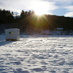 An ice fishing shack on the frozen West River in Brattleboro, Vermont. Bob house.