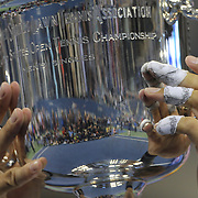 The taped up fingers of Rafael Nadal, Spain, with the trophy after beating Novak Djokovic, Serbia, during the Men's Singles Final at the US Open, Flushing. New York, USA. 9th September 2013. Photo Tim Clayton