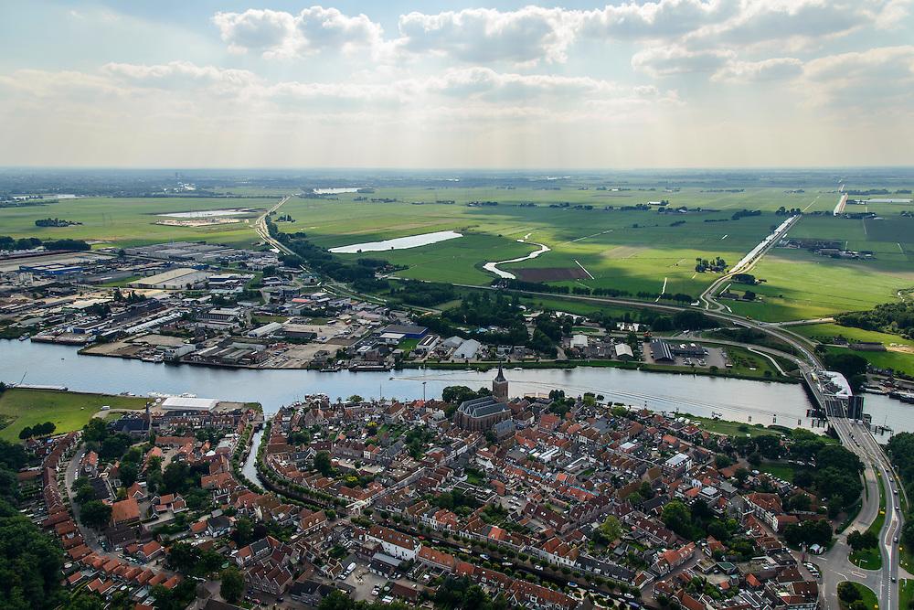 Nederland, Overijssel, Gemeente Zwartewaterland, 27-08-2013; Hasselt aan het Zwarte Water. Jachthaven met plezierjachten  en andere watersport. Brug van de N331 is open voor scheepvaartverkeer.<br /> The village of Hasselt on the river Zware Water.<br /> luchtfoto (toeslag op standaard tarieven);<br /> aerial photo (additional fee required);<br /> copyright foto/photo Siebe Swart.