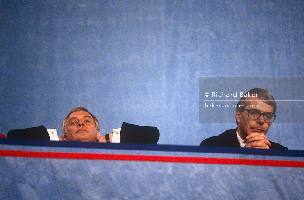 British Prime Minister, John Major (centre) with Secretary of State for the Environment, Chris Patten (left) listen to speeches at the Conservative party conference on 11th October 1991 in Blackpool, England.