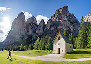 Saint Sylvester's Chapel (San Silvestro), Vallunga/Langental, Puez Group, Dolomites, South Tyrol, Italy, Europe. The beautiful ski resort of Selva di Val Gardena (German: Wolkenstein in Gröden; Ladin: Sëlva Gherdëine) makes a great hiking base in the Trentino-Alto Adige/Südtirol (South Tyrol) region of Italy. For our favorite hike in the Dolomiti, start from Selva with the first morning bus to Ortisei or St. Christina, take the Seceda lift, admire great views up at the cross on the edge of Val di Funes (Villnöss), then walk 12 miles (2000 feet up, 5000 feet down) via the steep pass Furcela Forces De Sieles (Forcella Forces de Sielles) to beautiful Vallunga (trail #2 to 16), finishing where you started in Selva. The hike traverses the Geisler/Odle and Puez Groups from verdant pastures to alpine wonders, all preserved in a vast Nature Park: Parco Naturale Puez-Odle (German: Naturpark Puez-Geisler; Ladin: Parch Natural Pöz-Odles), including the deeply glaciated U-shaped valley of Vallunga (Langental). As sheep and cows graze en route, Saint Sylvester's Chapel (San Silvestro) in Vallunga is fittingly dedicated to the patron saint of cattle and contains 300-year-old frescoes depicting the life of Jesus. UNESCO honored the Dolomites as a natural World Heritage Site in 2009. This panorama was stitched from 4 overlapping photos.