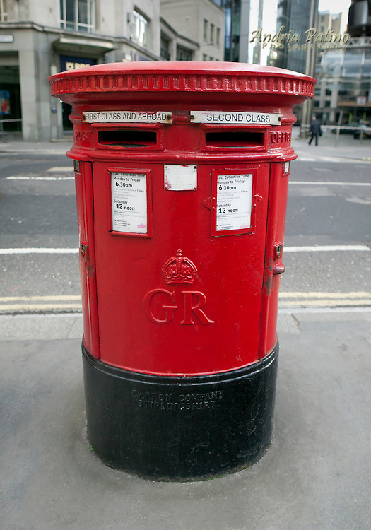 Red mail box on the street of London