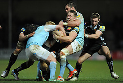 Exeter Chiefs Sam Hill is tackled by Newcastle Falcons Gonzalo Tiesi - Photo mandatory by-line: Harry Trump/JMP - Mobile: 07966 386802 - 14/02/15 - SPORT - Rugby - Aviva Premiership - Sandy Park, Exeter, England - Exeter Chiefs v Newcastle Falcons
