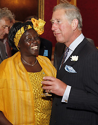 The Prince of Wales, right, Patron of the University of Cambridge Programme for Sustainability Leadership, talks with Kenya's Professor Wangari Maathai the winner of the Nobel Prize in Peace in 2004, during a reception for Nobel Laureates and climate change experts at St James's Palace in London.