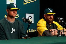 OAKLAND, CA - AUGUST 01:  Jon Lester #31 of the Oakland Athletics and Jonny Gomes #15 speak during a press conference before the game against the Kansas City Royals at O.co Coliseum on August 1, 2014 in Oakland, California. (Photo by Jason O. Watson/Getty Images) *** Local Caption *** Jon Lester; Jonny Gomes