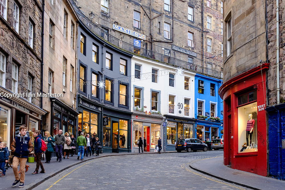 View of shops on historic Victoria Street and West Bow in Old Town of Edinburgh Scotland United Kingdom