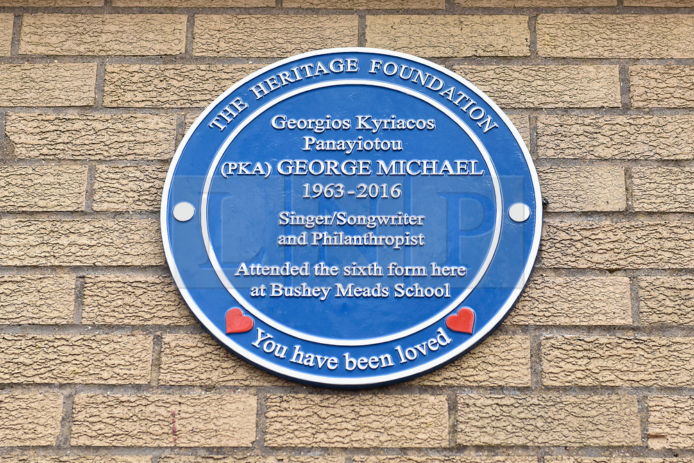© Licensed to London News Pictures. 15/04/2018. BUSHEY, UK.  A blue plaque commemorating the life of singer George Michael is unveiled at Bushey Meads school in Bushey, north west London.  George Michael was a student at the school for two years prior to finding success with Andrew Ridgeley in the group Wham! before moving on to a successful solo career.   The blue plaque was made possible by the George Michael Appreciation Society and the Heritage Foundation.  Photo credit: Stephen Chung/LNP