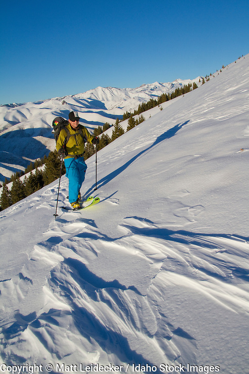 backcountry skier hikes in the pioneer mountains near ketchum and sun valley idaho.