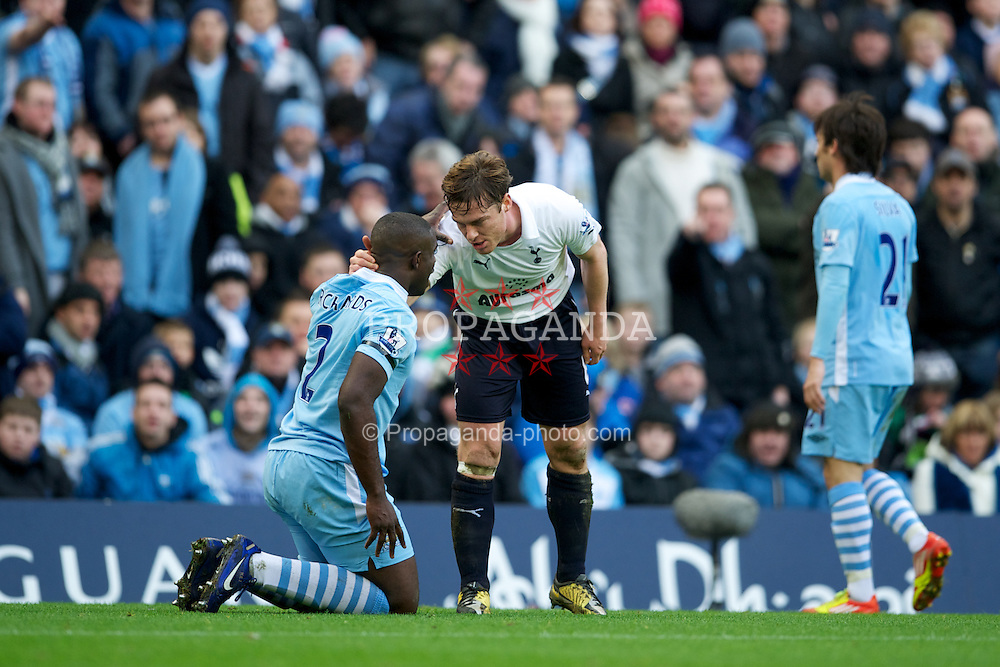 MANCHESTER, ENGLAND - Sunday, January 22, 2011: Tottenham Hotspur's Scott Parker and Manchester City's captain Micah Richards during the Premiership match at the City of Manchester Stadium. (Pic by David Rawcliffe/Propaganda)