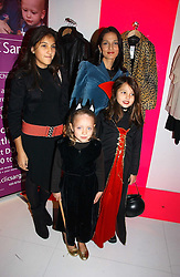 Left to right, YASMIN MILLS, her daughters LAUREN MILLS and  MADDIE MILLS with (front) LOLA TRAVERS at a party to celebrate the launch of DKNY Kids and Halloween in aid of CLIC Sargent and RX Art held at DKNY, 27 Old Bond Street, London on 31st October 2006.<br /><br />NON EXCLUSIVE - WORLD RIGHTS