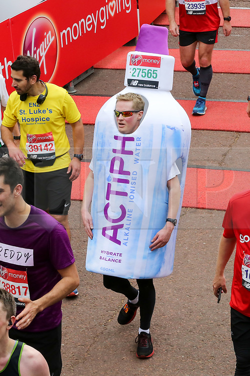 © Licensed to London News Pictures. 28/04/2019. London, UK. A runner in fancy dress at the finish of 2019 Virgin Money London Marathon. Photo credit: Dinendra Haria/LNP
