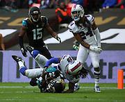 Jacksonville Jaguars T.J. Yeldon scoring a touchdown during the Buffalo Bills v Jacksonville Jaguars NFL International Series match at Wembley Stadium, London, England on 25 October 2015. Photo by Matthew Redman.