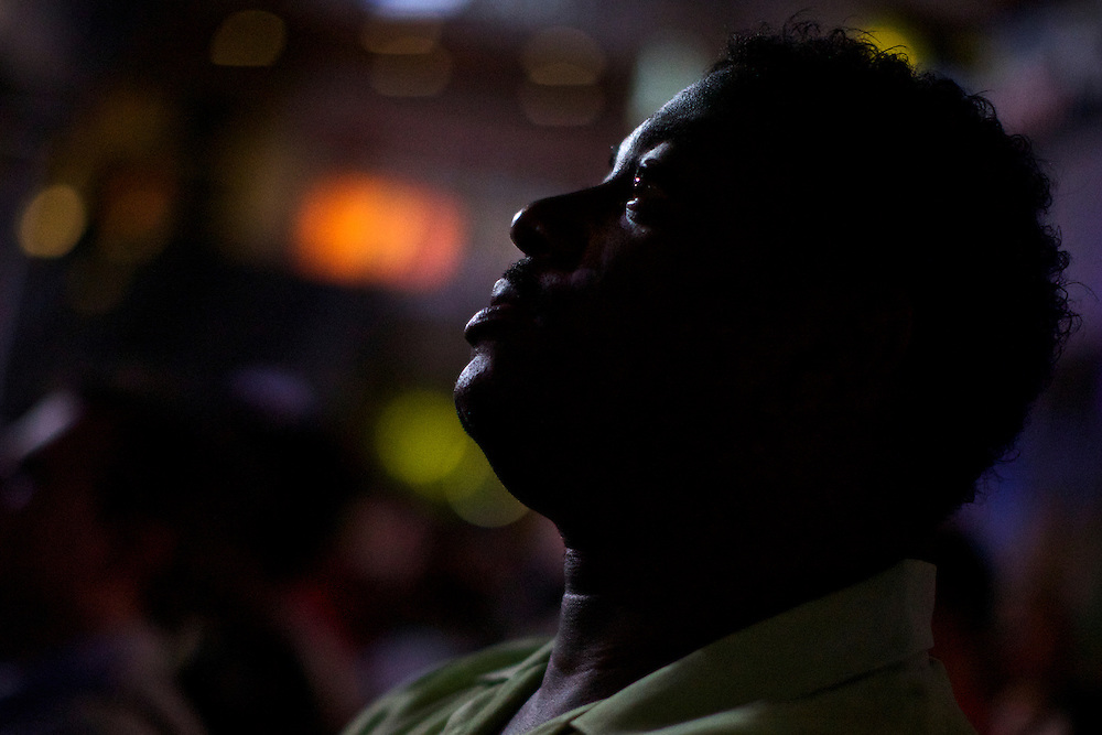 A spectator watches live video of President Bill Clinton's speech in Charlotte, NC during the 2012 Democratic National Convention on Sept. 5, 2012.