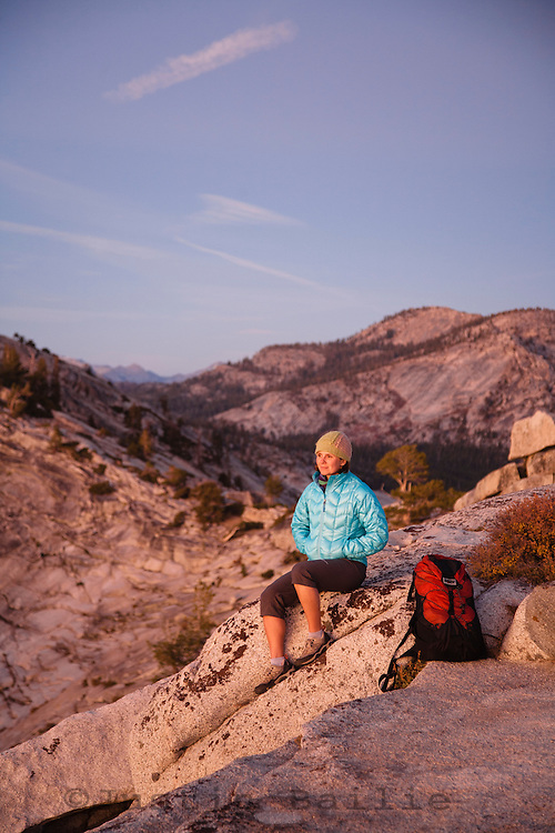 Young woman backpacking in Yosemite National Park.