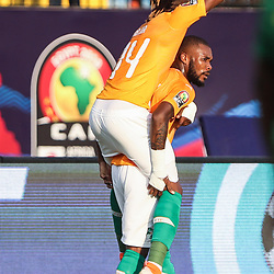 24 June 2019, Egypt, Cairo: Ivory coast's Jonathan Kodjia celebrates scoring his side's first goal with teammate Serey Die during the 2019 Africa Cup of Nations Group D soccer match between South Africa and Ivory coast at Al-Salam Stadium. Photo : PictureAlliance / Icon Sport