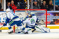 KELOWNA, BC - OCTOBER 16:  Isaac Poulter #1 of the Swift Current Broncos makes a save against the Kelowna Rockets at Prospera Place on October 16, 2019 in Kelowna, Canada. (Photo by Marissa Baecker/Shoot the Breeze)