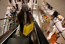 UK ENGLAND LONDON 8SEP16 - A shopper on the escalator of the Selfridge's department store in Oxford Street, central London.<br /> <br /> jre/Photo by Jiri Rezac<br /> <br /> © Jiri Rezac 2016