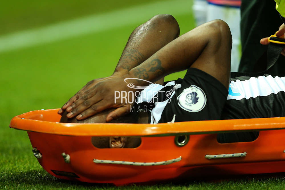Jetro Willems (#15) of Newcastle United reacts after suffering an injury that sees him carried from the field during the Premier League match between Newcastle United and Chelsea at St. James's Park, Newcastle, England on 18 January 2020.