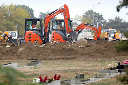 March 18, 2019 - Christchurch, New Zealand - Workers dig graves at at a Muslim cemetery for the victims of a mass shooing in which at least 50 people were killed and 36 injured at two mosques on Friday, 15 March. (Credit Image: © Sanka Vidanagama/NurPhoto via ZUMA Press)