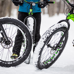 Fat tire biking on a snowy winter day in New Hampshire's White Mountains. Close-up.
