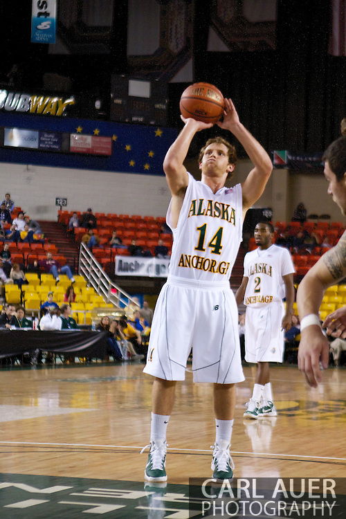 November 25th, 2010:  Anchorage, Alaska - University of Alaska-Anchorage guard Steve White (14) shoots a free throw in the Seawolves 54-86 loss to Weber State in the first round of the Great Alaska Shootout.
