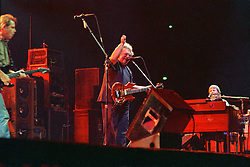 Jerry Garcia, right arm shot up! in performance with The Grateful Dead Live at The Civic Center, Hartford Connecticut 18 March 1990. Stage Close, in The Pit, image capture.