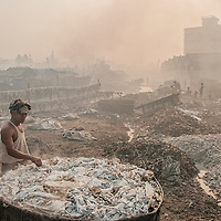 A man working in open lather plant in Hazaribag, Dhaka. This inmost polluted part of the city.