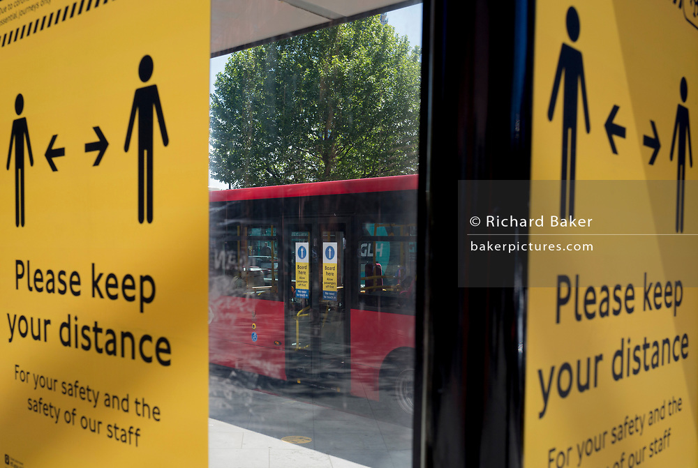 In the UK, 32,313 people have now died after testing positive for coronavirus which is now the highest death toll in Europe, even exceeding that of Italy. With UK lockdown continuing, a detail of the graphics for social distancing measures which are posted at bus stops around the capital in preparation of a return to work and public transport for some workers in the near future, on 5th May 2020, in London, England.