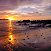 Sunset on the beach of Playa Brasalito in Guanacaste, Costa Rica.