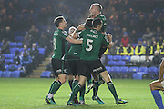 Scunthorpe United midfielder Neil Bishop (12) celebrates with team mates after the second goal during the League 1 match between Peterborough United and Scunthorpe United at London Road, Peterborough, England on 22 November 2016. Photo by Nigel Cole.