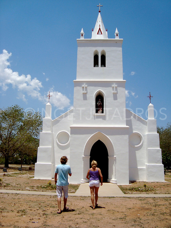 Dutch mother and son visiting the Beagle Bay Church in Beagle Bay, Dampier Peninsula,Western Australia Published in Korean Air Inflight Magazine 'Morning Calm', April 2013