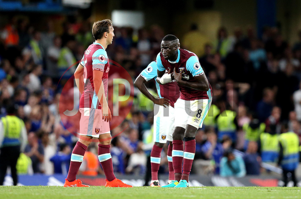 Cheikhou Kouyate of West Ham United looks frustrated at Mark Noble of West Ham United after Diego Costa of Chelsea scores a late goal - Mandatory by-line: Robbie Stephenson/JMP - 15/08/2016 - FOOTBALL - Stamford Bridge - London, England - Chelsea v West Ham United - Premier League