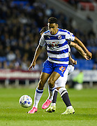 Nick Blackman holds off a challenge during the Sky Bet Championship match between Reading and Derby County at the Madejski Stadium, Reading, England on 15 September 2015. Photo by David Charbit.