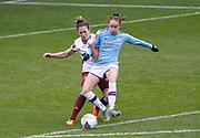Manchester City Women's forward Tessa Wullaert (25) and West Ham United Women defender Laura Vetterlein (26) in action during the FA Women's Super League match between Manchester City Women and West Ham United Women at the Sport City Academy Stadium, Manchester, United Kingdom on 17 November 2019.
