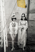 girls dressed up in Asian clothing backstage at a circus France ca 1960s