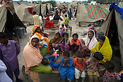 People displaced by the floods sit in a camp in the city of Sukkur, in Sindh Province, Pakistan.
