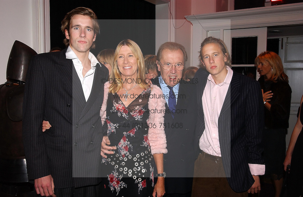 Left to right, MR WILFRED FROST, SIR DAVID & LADY CARINA FROST and MR GEORGE FROST at a party hosted by jeweller Theo Fennell and Dominique Heriard Dubreuil of Remy Martin fine Champagne Cognac entitles 'Hot Ice' held at 35 Belgrave Square, London, W1 on 26th October 2004.<br />