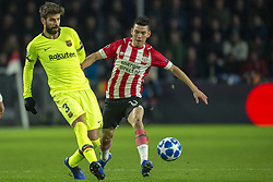 November 28, 2018 - Eindhoven, Netherlands - Gerard Pique of Barcelona and Hirving Lozano of PSV fight for the ball during the UEFA Champions League Group B match between PSV Eindhoven and FC Barcelona at Philips Stadium in Eindhoven, Netherlands on November 28, 2018  (Credit Image: © Andrew Surma/NurPhoto via ZUMA Press)