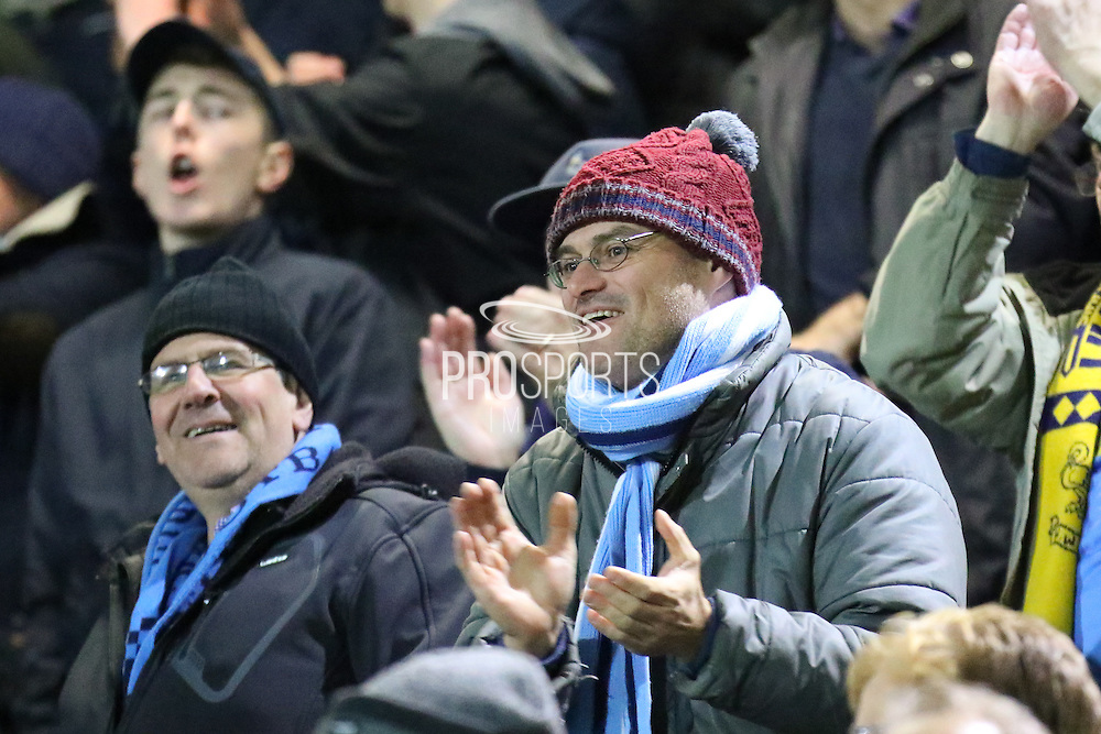 Wycombe Wanderers fans celebrate the win during the The FA Cup match between Chesterfield and Wycombe Wanderers at the Proact stadium, Chesterfield, England on 3 December 2016. Photo by Aaron Lupton.