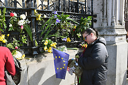 Floral tributes outside Parliament for the victims of the terrorist attack on 22 March 2017. Unite for Europe (anti Brexit) march to Parliament, a few days before Article 50 is due to be triggered.  London 25 March 2017 UK