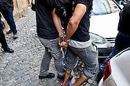 Roma 4  Novembre 2013<br /> Sgomberato uno stabile in Via Giusti, al quartiere Esquilino , occupato dai movimenti di lotta per la casa lo scorso 13 ottobre, 20 le persone indentificate e 2  portate via in manette, sono state lanciate suppellettili e mobilio dalle finestre  per  resistere allo sgombero contro la polizia. Uno dei due  fermati portato via dalla polizia<br /> Rome, 4 November 2013<br /> Eviction  a building  in Via Giusti, the Esquilino district , occupied by the movements of struggle for the house last October 13, 20 people identified, two taken away in handcuffs, furnishings and furniture were thrown from the windows to resist the eviction against the police.One of the two suspects taken away by police