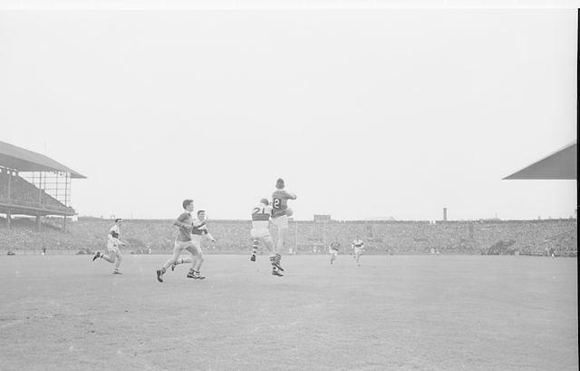 Players challenge mid air for ball during the All Ireland Minor Gaelic football final Derry v. Kerry in Croke park on the 26th September 1965.