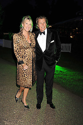 THEO & LOUISE FENNELL at the Royal Parks Foundation Summer Party hosted by Candy & Candy on the banks of the Serpentine, Hyde Park, London on 10th September 2008.